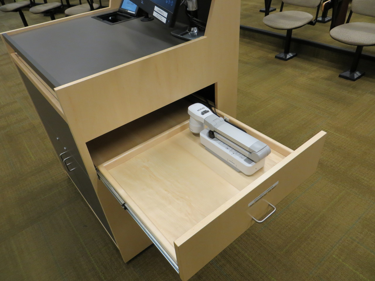Podium with document camera shelf extended